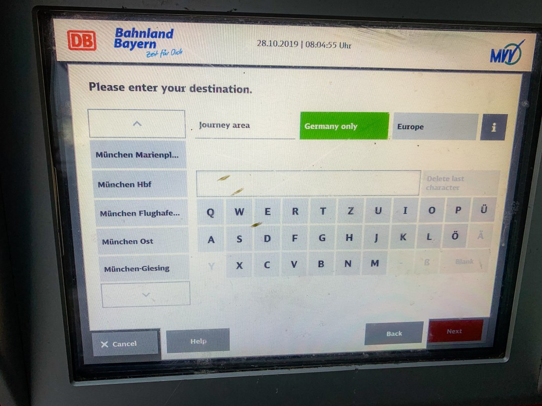The screen of a Munich public transport ticket machine showing a keyboard and destinations