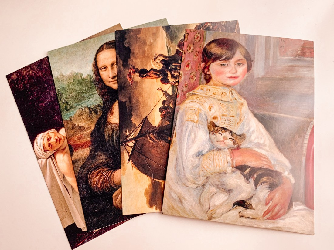 Postcards featuring famous artworks from French museums, including the Mona Lisa and Raft of the Medusa.
