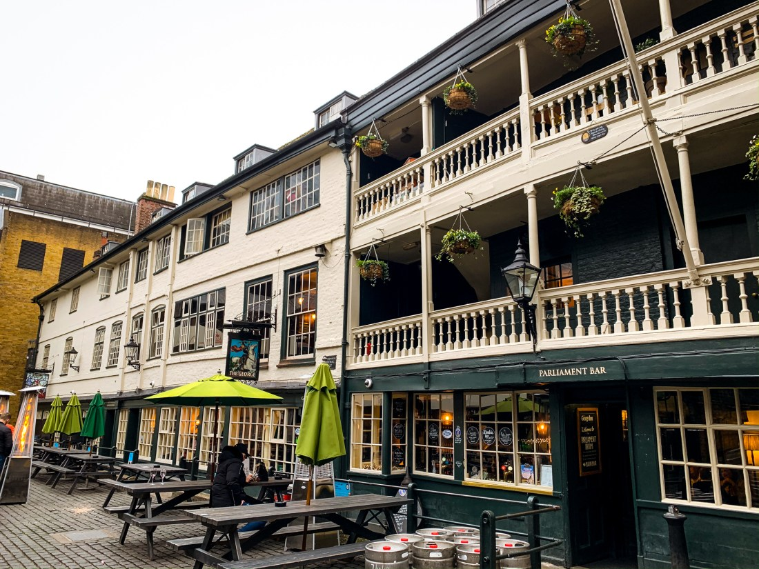 The outside of the George Inn, a medieval pub with balconies.