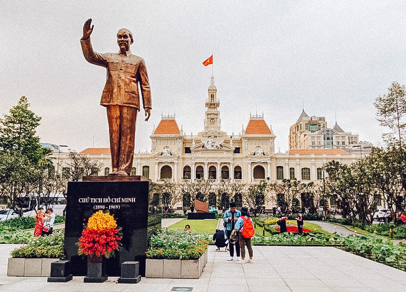 Ho Chi Minh City in Vietnam, with a statue in front of a palace. Vietnam is one of the best cheap places to travel in Asia.