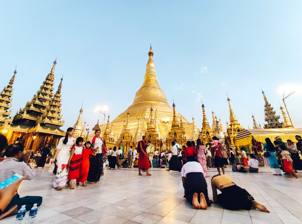Woshippers pray at the golden temple in Yangon, Myanmar.