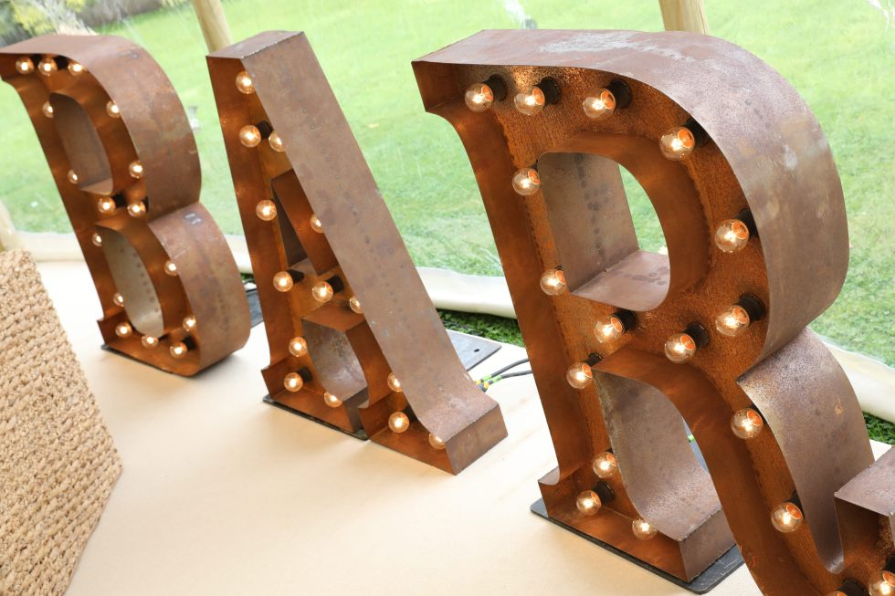 real marquee wedding inspiration - BAR sign
