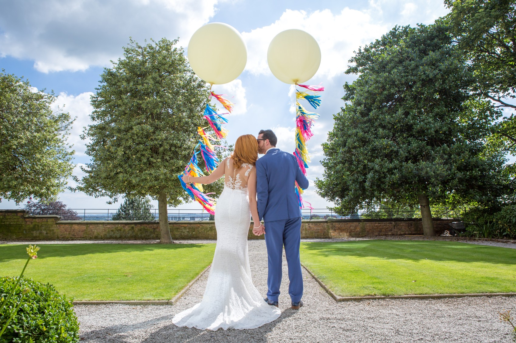 a colourful wedding - harts nottingham garden wedding - giant balloons at wedding - alterntive wedding planner