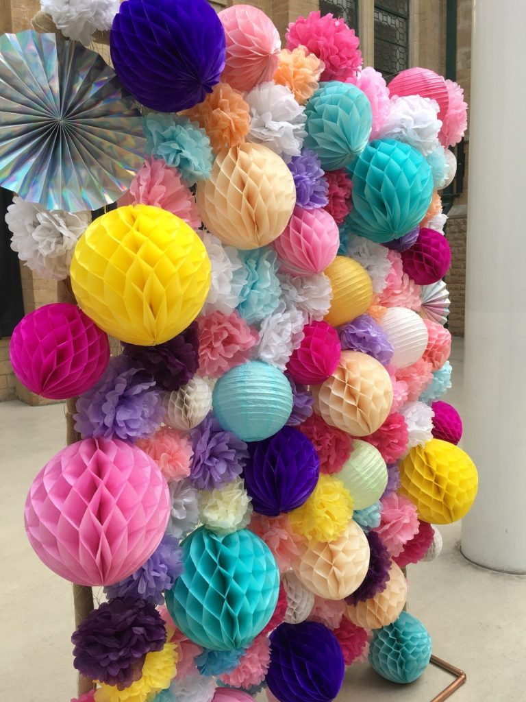 Bespoke pom pom wall - wedding colourful - wedding styling - alternative wedding - colourful ceremony backdrop