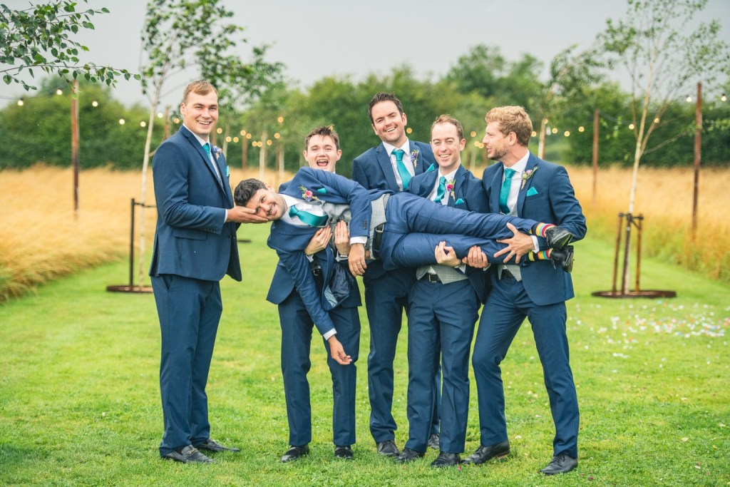 B&A wedding day - Oaktree farm outdoor wedding venue in nottinghamshire / lincolnshire - groomsman group shot on the grass
