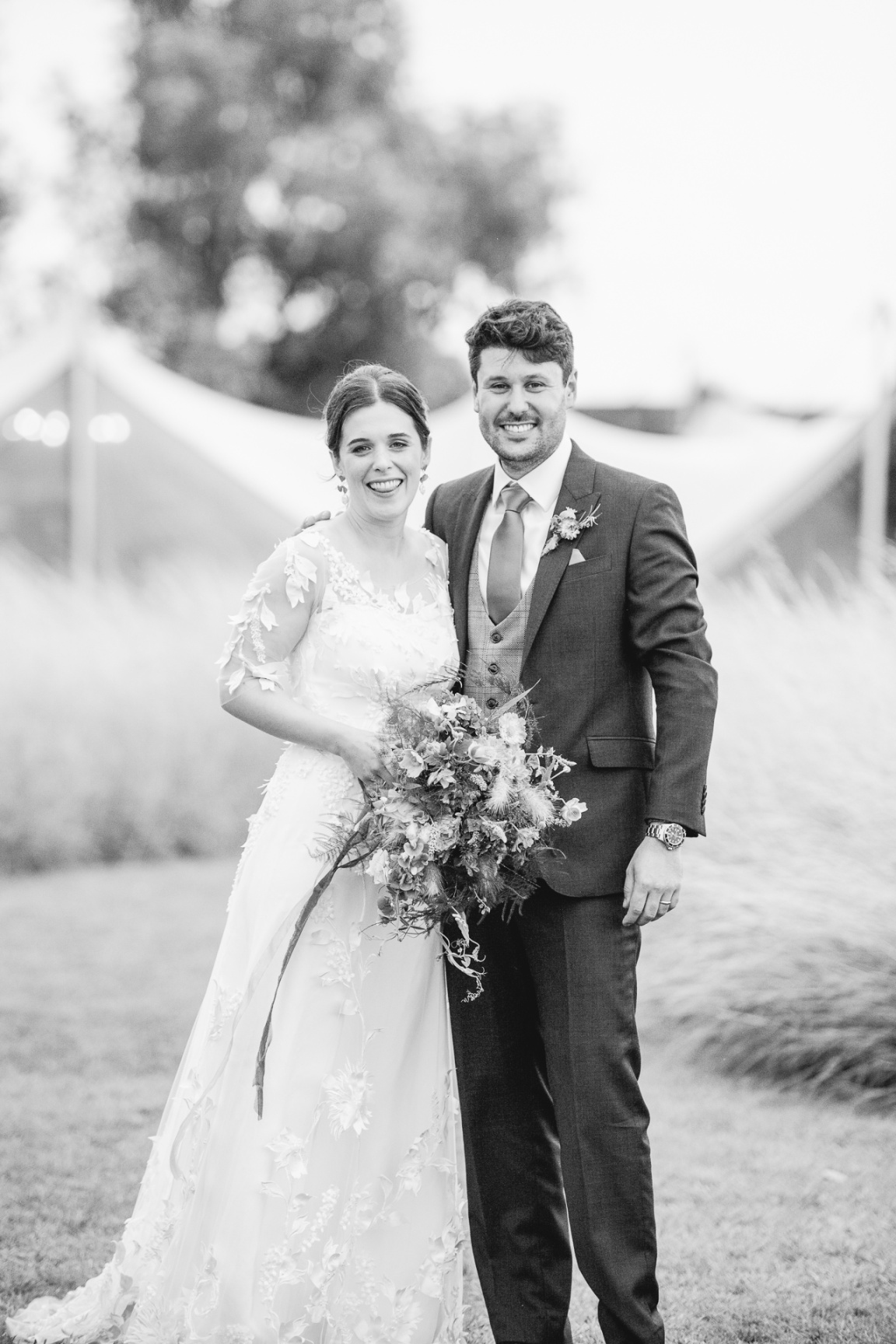 B&A wedding day - Oaktree farm outdoor wedding venue in nottinghamshire / lincolnshire - couple smiling - black & white photo