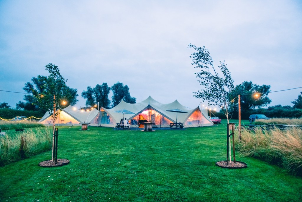 B&A wedding day - Oaktree farm outdoor wedding venue in nottinghamshire / lincolnshire - stretch tent at twilight