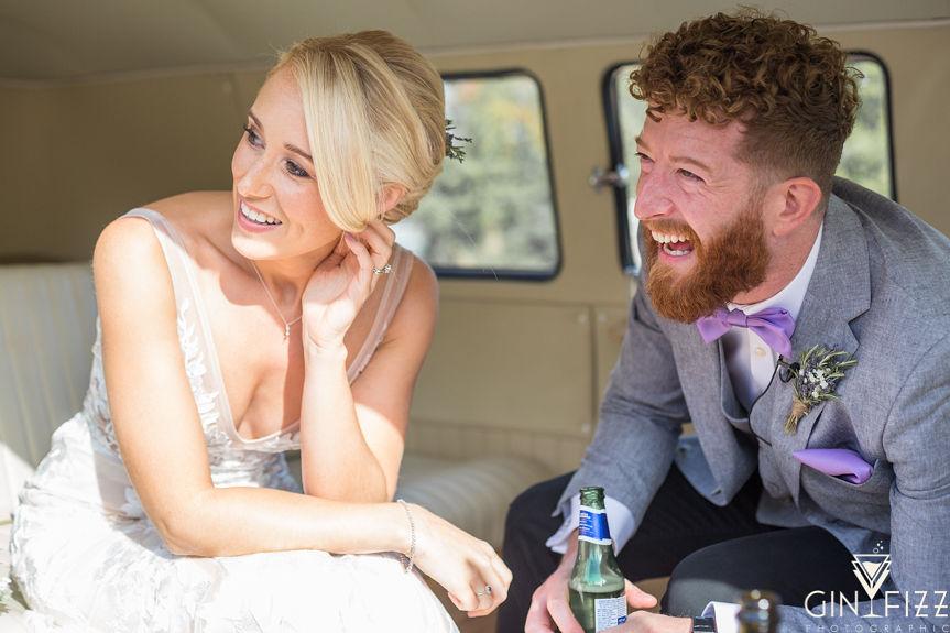 B&N barn wedding day - bride and groom sitting in VW campervan in drinks reception
