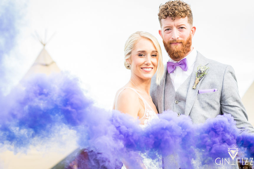 B&N outdoor wedding day - couple bride and groom with purple smokebomb and tipi in the background 2