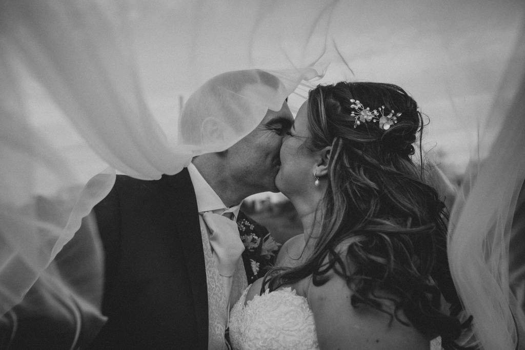 wedding veil blowing in the wind - romantic wedding photo - rutland wedding - fun wedding - east midlands wedding planner - Leicestershire wedding planning - nottingham wedding planning