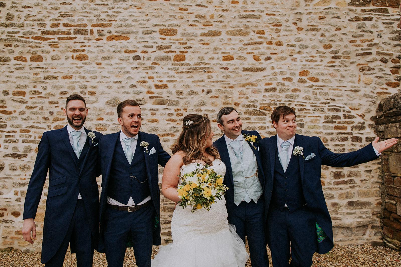 bride with groomsmen - rutland wedding - fun wedding - east midlands wedding planner - Leicestershire wedding planning - nottingham wedding planner
