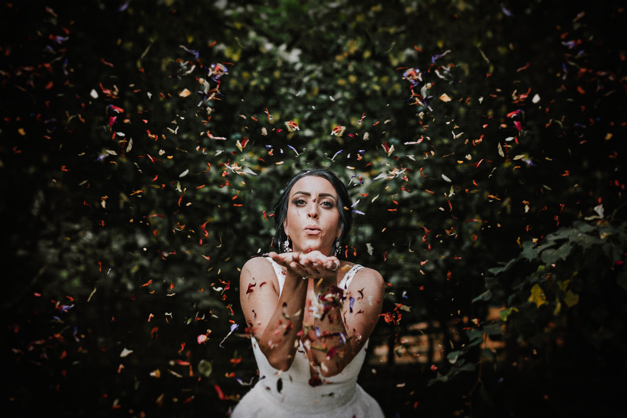 Woodland Wedding - nottingham outdoor wedding venue - east midlands wedding planner - bride with confetti