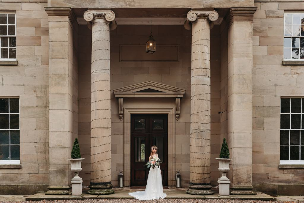 The grand entrance at Fillongley Hall, Warwickshire marquee venue - Bride standing in the door