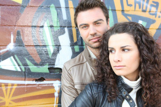 Couple in front of a Graffiti wall