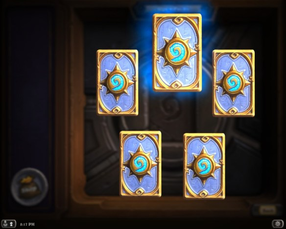 Five face-down Hearthstone cards, with a rare being hovered over