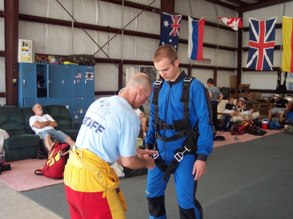 man being prepared to skydive