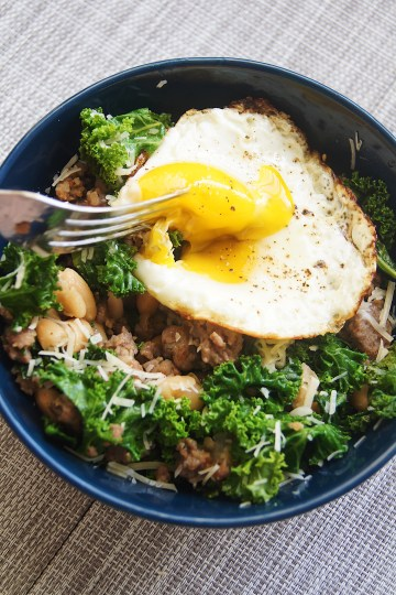 Kale-Bean-and-Sausage-Skillet-egg-yolk-broken-with-fork