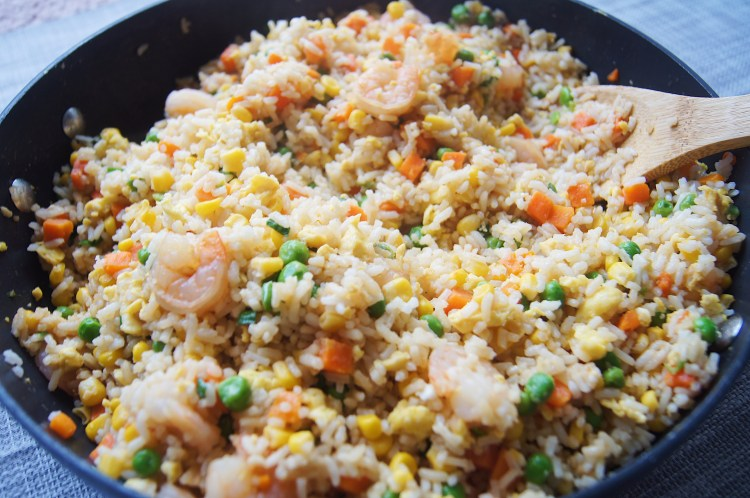 One-Pot-Shrimp-Fried-Rice-01-in-a-skillet-with-wooden-spoon