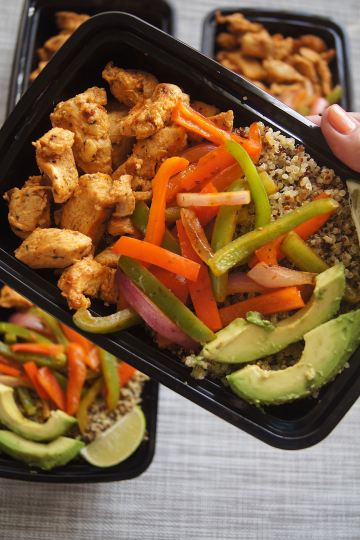 Chicken-Fajita-and-Quinoa-Bowl-hand-holding-bowl