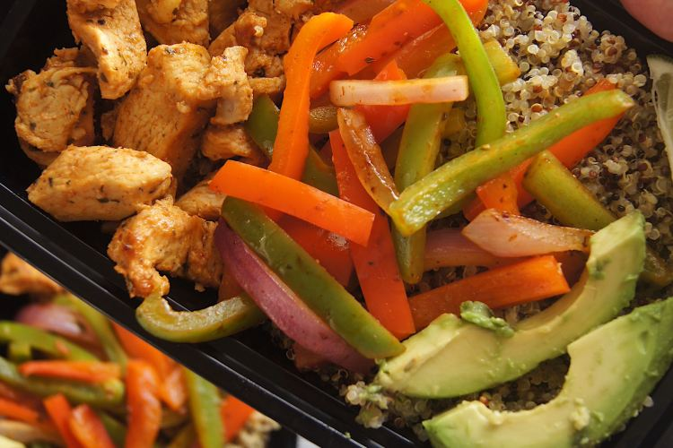 Chicken-Fajita-and-Quinoa-Bowl-hand-holding-bowl