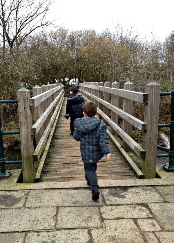boys running on bridge