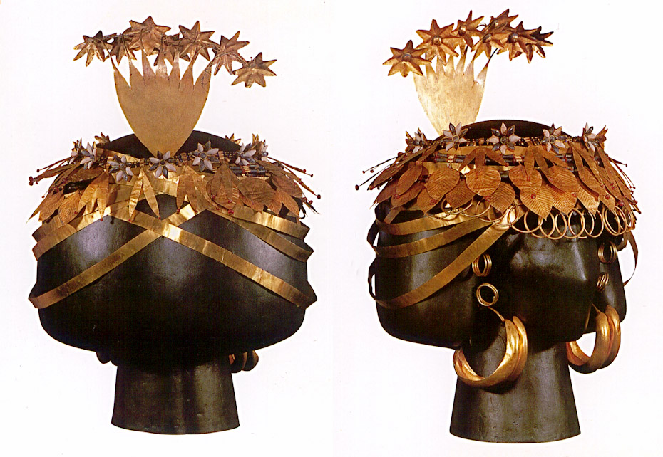gold headdress of leaves flowers and rings on a black model head, reconstruction of Quenn Puabi's burial at Ur, Mesopotamia 2600 BC