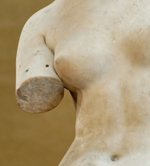 Closeup on fixture holes on arm of venus de milo for attaching original jewellery