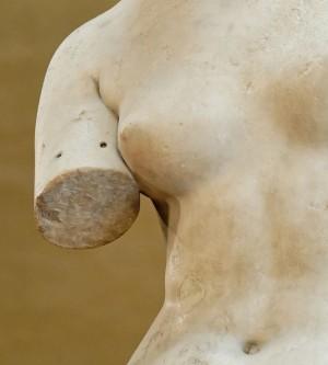 Closeup on fixture holes on arm of venus de milo for attaching original jewellery