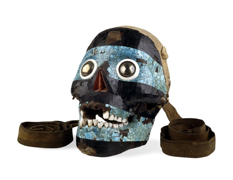 Human skull decorated with turquoise and onyx with iron agate eyes and leather straps for wering. Aztec, 16th Century AD, British Museum