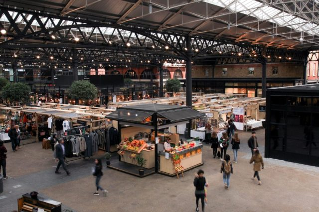 Food and clothing stalls under the covered Spitalfields Market
