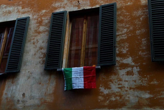 Italian Flag outside of a windown during coronavirus