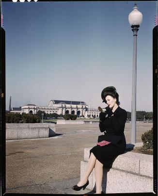 flickr_-_the_library_of_congress_-_woman_putting_on_her_lipstick_in_a_park_with_union_station_behind_her2c_washington2c_d-c-_28loc29