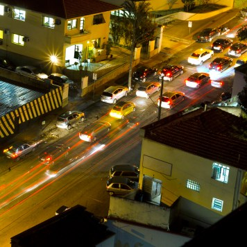 Night time lapse photo of cars with blurred lights