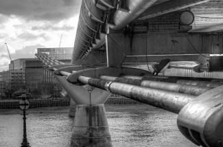 black and white view of bottom, Millenium bridge, London