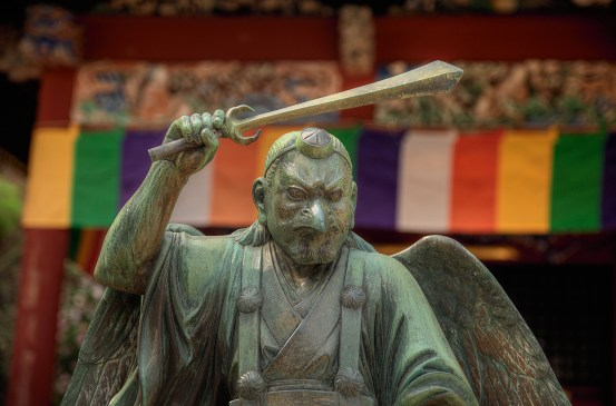 Winged Statue with Raised Sword