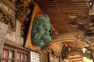 Wooden Temple Roof with Statue Face