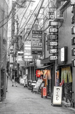 Many signs in the alley