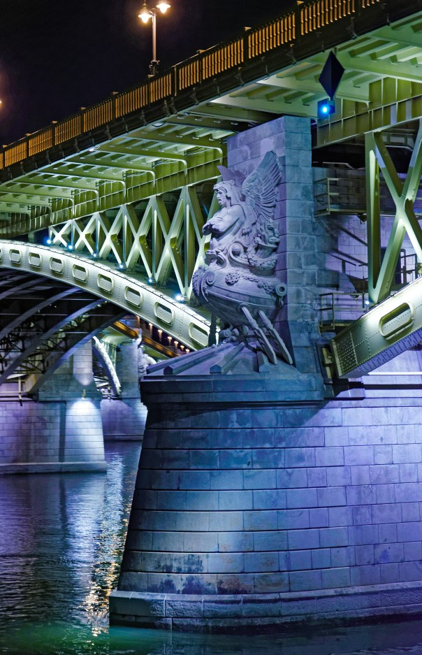 Statue on Bridge support at night