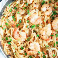 Black pan with assorted seafood and jumbo prawns cream sauce fettuccine.