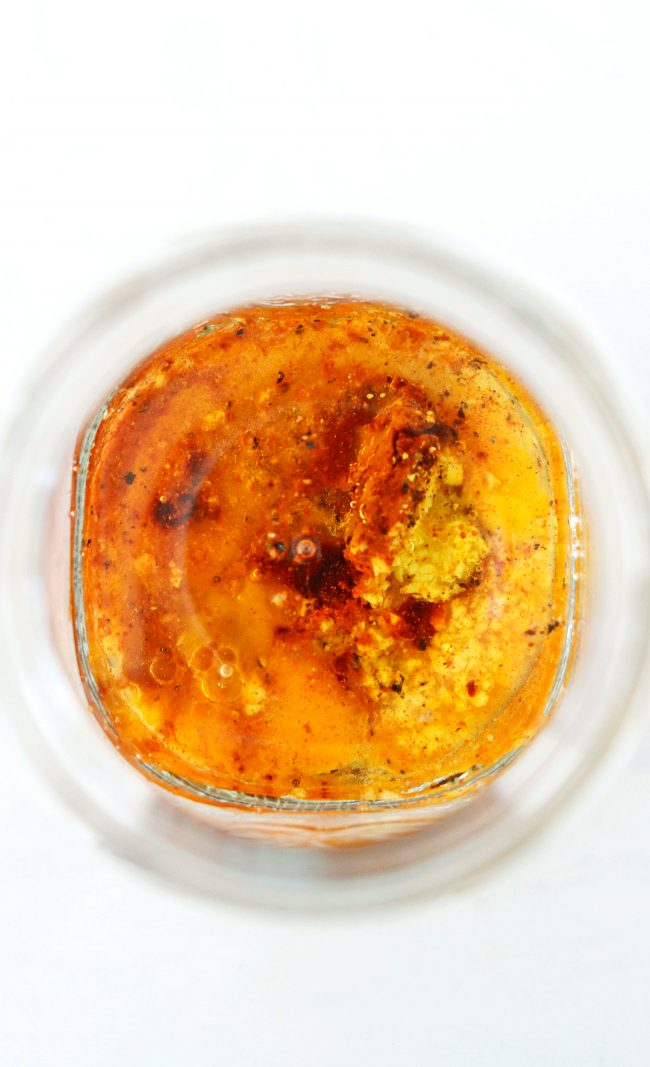 Ingredients for Homemade Spicy Mayonnaise in a glass jar