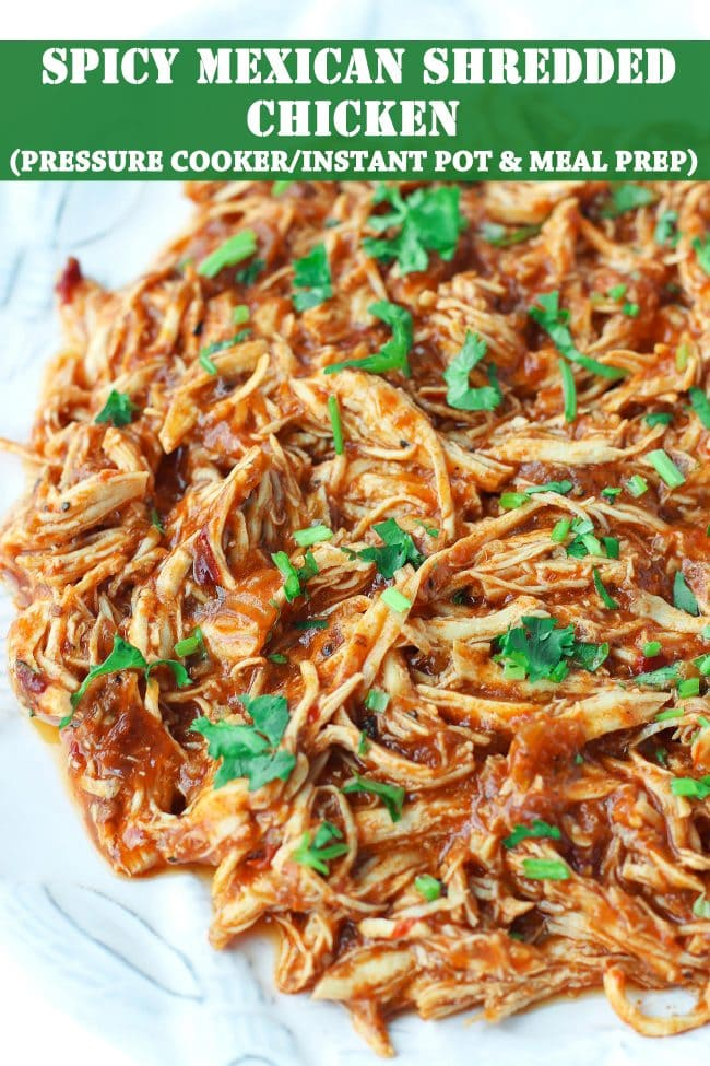 shredded spicy chicken with coriander on white plate