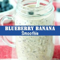 Blueberry Banana Smoothie in a mason jar mug with a straw in it.