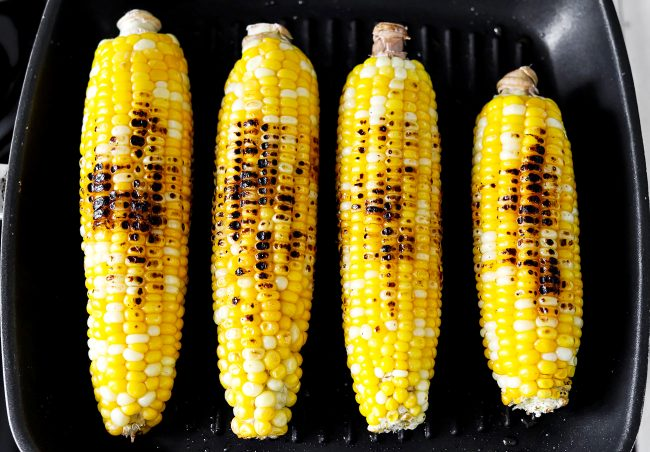 Corn grilling on pan-grill.