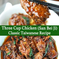 Chopsticks holding up chicken wing glazed in brown Asian sauces and white dish with San Bei Ji