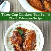 Two pieces of brown sauce glazed chicken wings with sauce on top of steamed white rice in a bowl with a spoon. Dish of San Bei Ji above the bowl. Spoon and chopsticks to the side of the bowl.