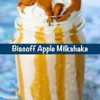 Biscoff Apple Milkshake in a mason jar glass with whipped cream, crumbled Biscoff cookies, and Biscoff spread drizzle.