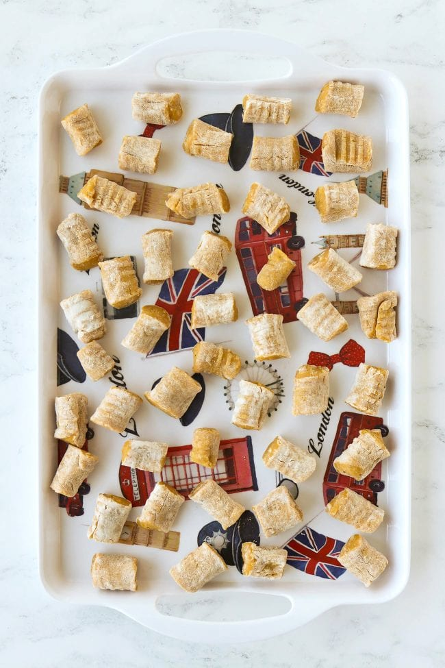 Gnocchi pieces scattered on a tray.