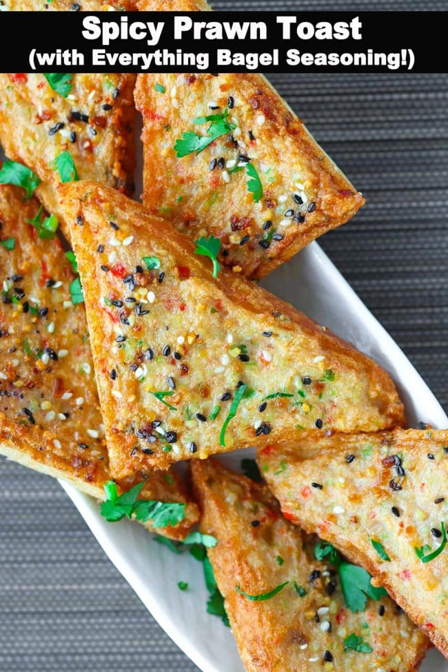 Close up of Spicy Prawn Toast triangles on a long plate garnished with chopped coriander.