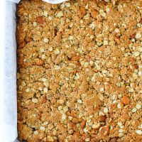 Apricot Almond Oat Slice baked slab in baking pan on top of cooling rack.
