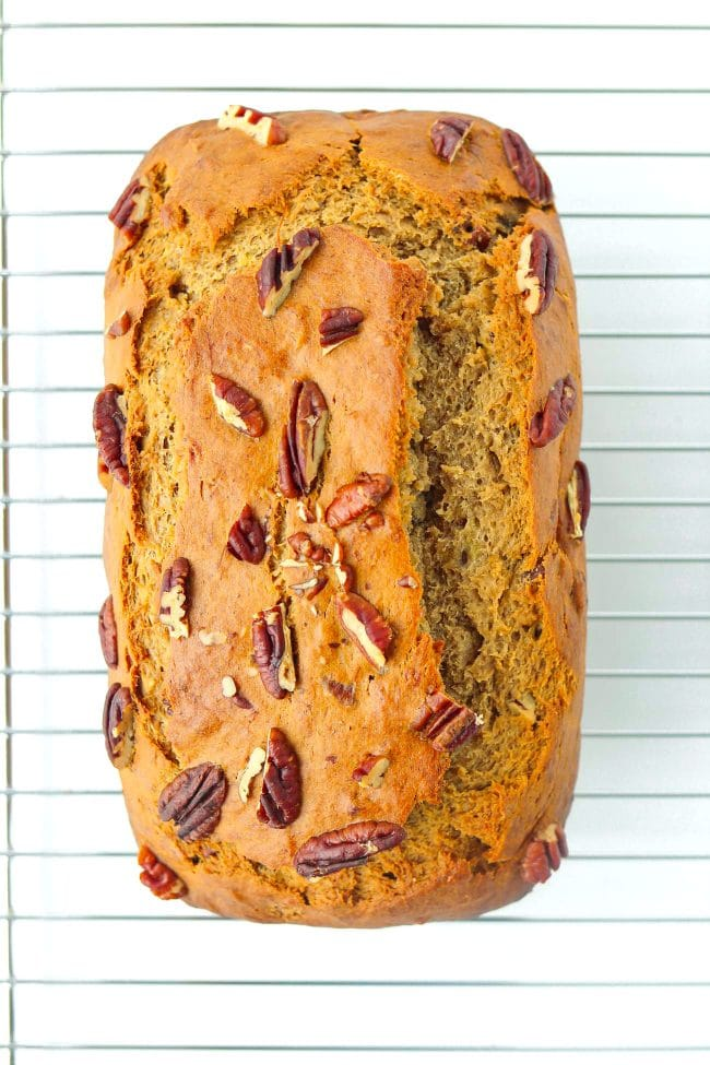 Baked banana pecan nut bread on top of cooling rack.